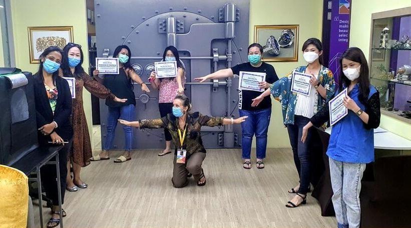 JDMIS graduates celebrate in mask